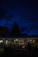 String lights illuminating outdoor patio dinner party
