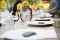 Menus under rocks on table at harvest dinner placesetting