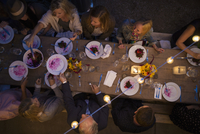 Overhead view friends enjoying outdoor dinner harvest party