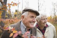 Smiling senior couple in autumn woods