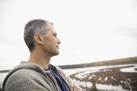Pensive man looking away at lake