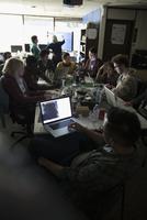 Hackers working hackathon at laptops in dark office 11096047745| 写真素材・ストックフォト・画像・イラスト素材|アマナイメージズ
