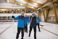 Portrait smiling senior men curling