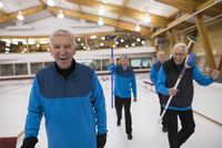 Portrait laughing senior men at curling club 11096048322| 写真素材・ストックフォト・画像・イラスト素材|アマナイメージズ