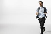 Businessman running against white background