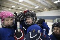 Girl and boy ice hockey players celebrating on ice hockey rink 11096050622| 写真素材・ストックフォト・画像・イラスト素材|アマナイメージズ