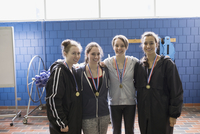 Portrait smiling teenage girl swimmers with medals at swim meet 11096053022| 写真素材・ストックフォト・画像・イラスト素材|アマナイメージズ