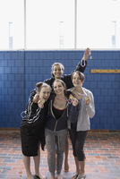 Portrait enthusiastic teenage girl swimmers with medals at swim meet 11096053024| 写真素材・ストックフォト・画像・イラスト素材|アマナイメージズ