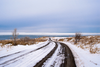 Blue sky over snowy road by sea, Abashiri, Hokkaido, Japan