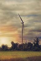 Wind turbine against overcast sky