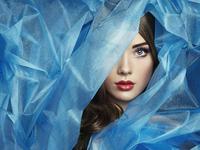 Fashion photo of beautiful women under blue veil
