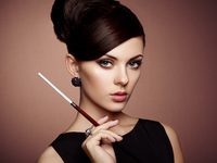Fashion photo. Retro portrait of beautiful woman with cigarette