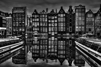 Townhouses reflecting in canal, Amsterdam, Holland