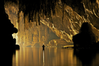 Silhouette of person in cave