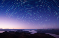 Star trails on sky over mountains, Sonnwendjoch, Austria