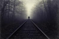 Silhouette of man walking on railroad tracks in fog, Brackendale, British Columbia, Canada