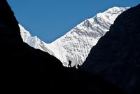Silhouette of man hiking in Himalayas, Nepal