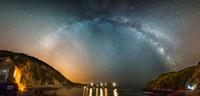 Milky Way on sky above Lulworth Cove, Dorset, England, UK