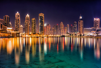 Skyline of illuminated Dubai at night, United Arab Emirates