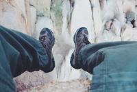 Man sitting on edge of rocky mountain