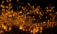 People launching sky lanterns at Loy Kratong festival, Chiangmai, Thailand