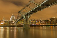 Millennium Bridge and St. Paul's Cathedral at dusk, London, England, UK