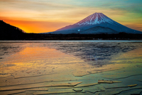 Frozen lake in front of Mt. Fuji at sunset, Japan