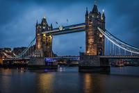 Illuminated Tower Bridge over Thames River at night, London, England, UK