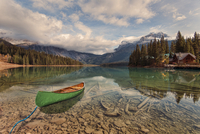 Canoe moored at shore of Emerald Lake with Canadian Rockies in background, Yoho National Park, British Columbia, Canada