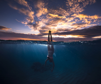 Woman diving into water