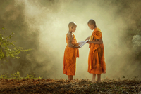 Two boys (16-17) dressed in buddhist monk robes, Thailand