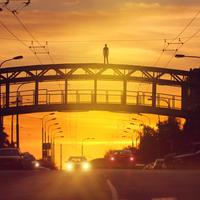 Silhouette of man on top of bridge