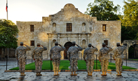 Soldiers saluting in front of building, San Antonio, Texas, USA