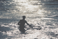 Silhouette of person in water