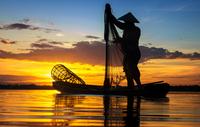 Silhouette of fisherman