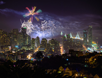 New year's fireworks over Bay Bridge and cityscape, San Francisco, California, USA