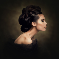 Portrait of beautiful young woman with fashionable hair bun