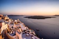 Sunset over city, Santorini, Greece