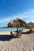 Beach table and umbrellas, Kuta, Lombok, Indonesia