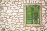 View of stone wall to green shutter