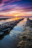 Rugged coast of Redcar at dawn, North Yorkshire, England, UK