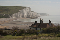 Clouds over Seven Sisters cliff and beach, East Sussex, England, UK