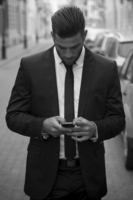 Man in suit using mobile phone, Hungary