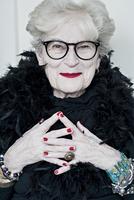 Portrait of smiling senior woman wearing eyeglasses, Prague, Czech republic