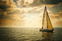 Sailboat sailing away, Laboe, Germany
