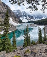 Lake at steep snowy mountains, Canada