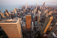 Aerial view of city at sunset, Chicago, Illinois, USA