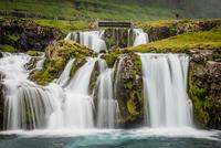Kirkjufellsfoss waterfall and green rocks, Iceland