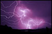 Lightning bolts piercing night sky