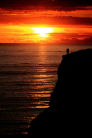 Silhouette of couple against sunset, Cormwall, England, UK